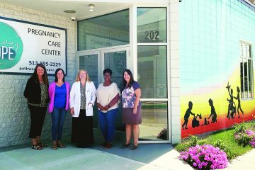 Lori Haskell, Leah Miley, Erin Shock, Jennifer Weddington and Nina Solomon outside Pathway to Hope, a pregnancy care center in Hamilton.