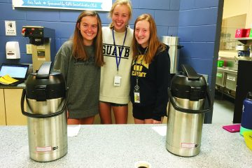 Student workers Alivia Hyland, Christine Moore and Deirdre Carroll.