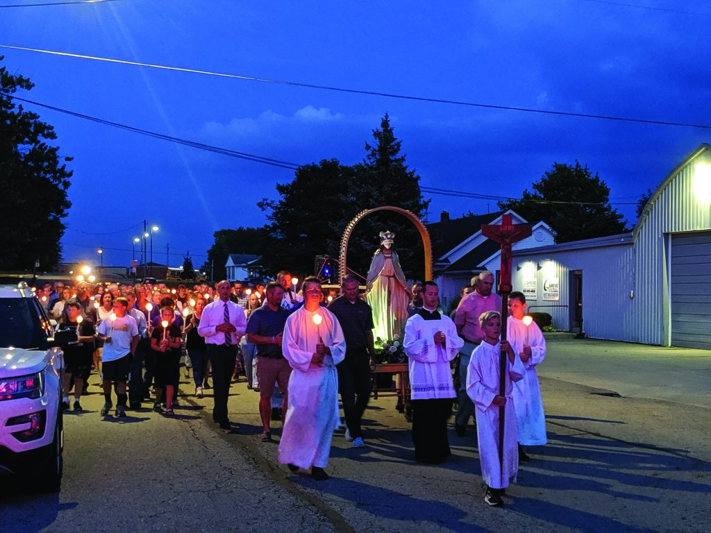 "The Petersburg Parishes kicked off a ""Year of Discipleship"" with a candlelit Marian Procession through the streets of Botkins on the Feast of the Assumption."