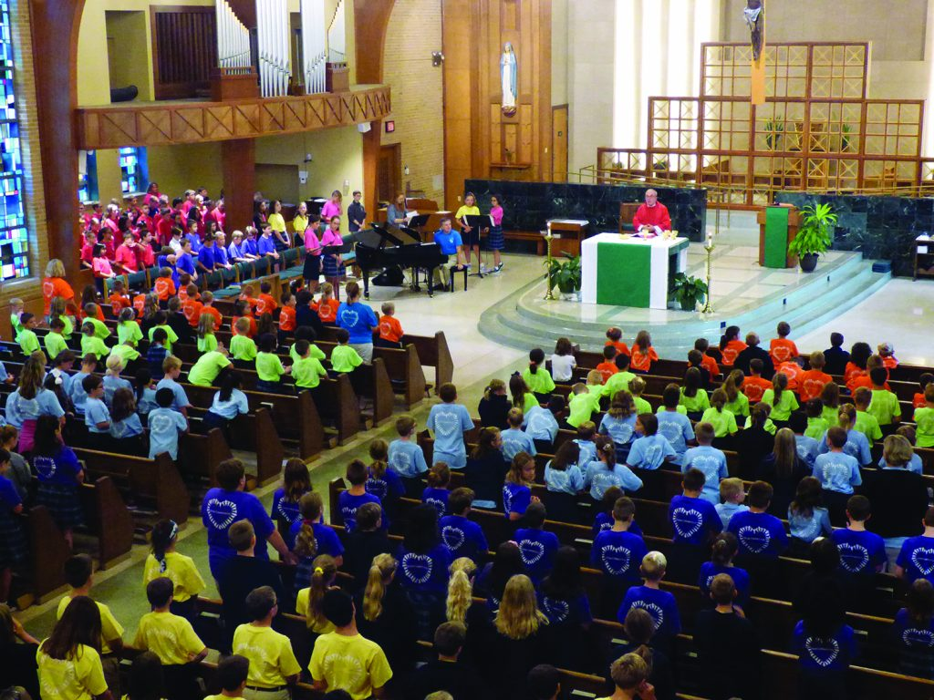 "St. Michael Parish School in Sharonville celebrated the first school Mass of the new year on Aug. 30. Students were a rainbow of faith in their new spirit shirts centered around the theme for the year: ""Building a Community of Love."""