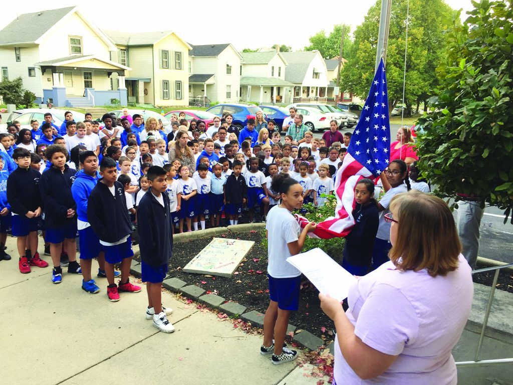 The students at Our Lady of the Rosary School in Dayton came together at the flagpole to remember, honor and pray for all those affected by the September 11 attacks.