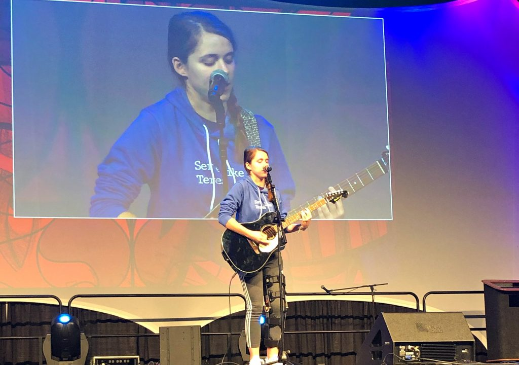 Miley Azbill of Kettering sings at the National Catholic Youth Conference in Indianapolis.