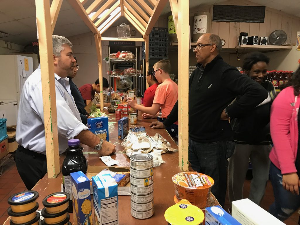 Holy Family Parish eighth grade Parish Religious Education Program (PREP) students visited the Middletown Family Services Choice Pantry. Executive director Maurice Maxwell explained how the pantry operates and students helped stock shelves.