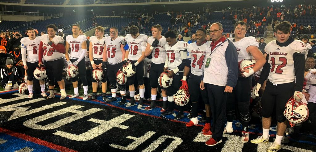 Coach Pat McLaughlin and squad ready to accept the trophy.
