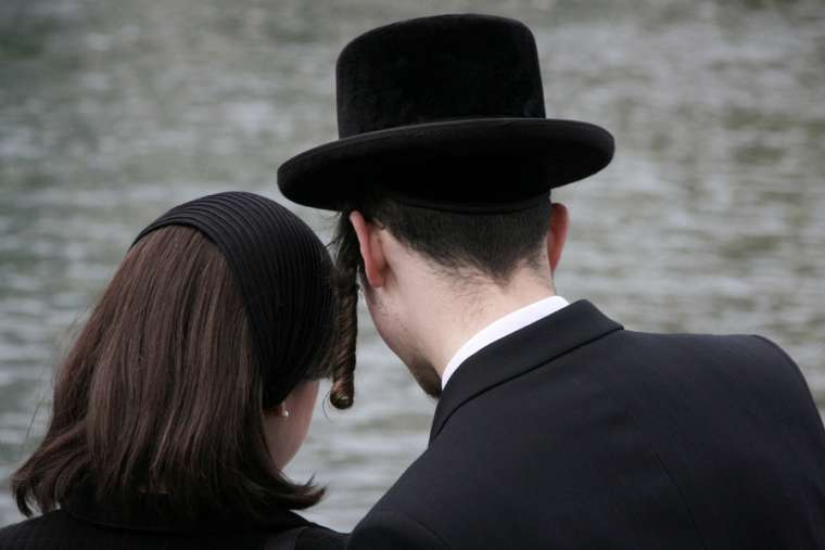 Orthodox Jewish couple. Stock photo via Shutterstock