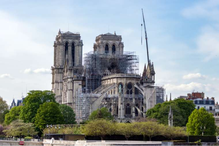 Notre-Dame de Paris shortly after a fire damaged parts of the roof and structure. Credit: UlyssePixel/Shutterstock