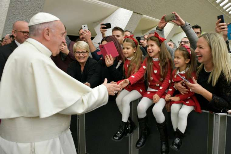 Pope Francis greets families of Vatican City employees Dec. 21, 2017. Credit: Vatican Media