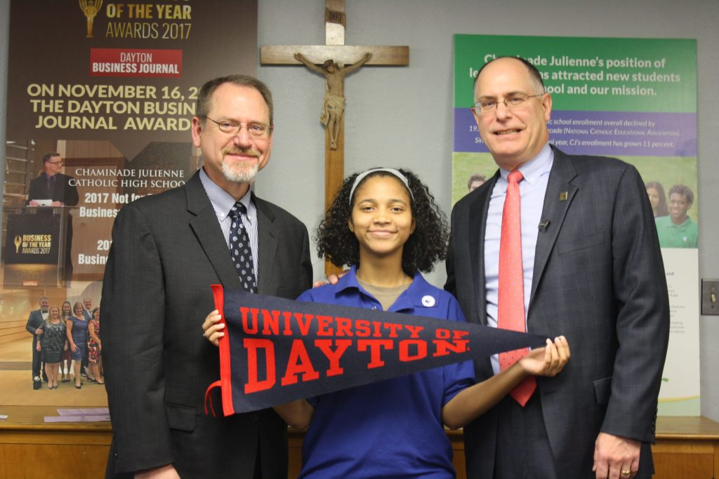 A Chaminade Julienne High School (CJHS) senior received a prestigious scholarship from the University of Dayton. Pictured: CJHS President Dan Meixner, student scholarship winner Havana Glover and University of Dayton President Eric Spina.