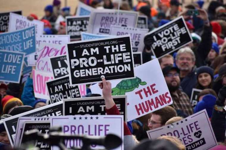 Students and other participants hold signs at the 2020 March for Life in Washington, DC, on Jan. 24, 2020. Credit: Peter Zelasko/CNA