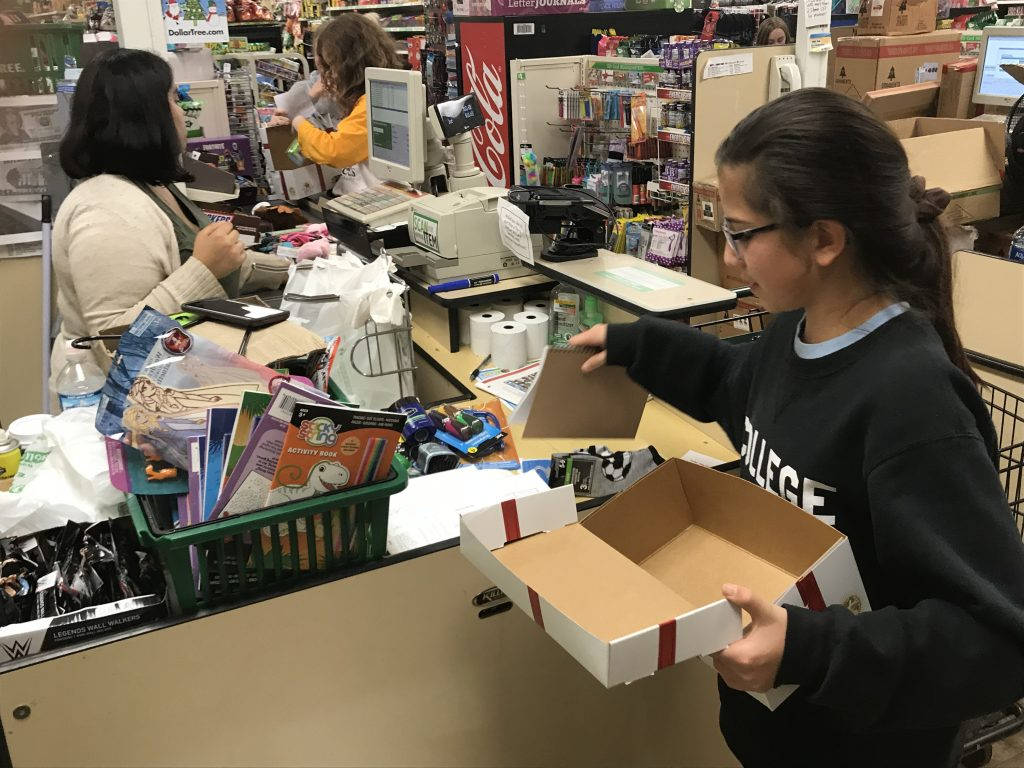 Claes purchases supplies to fill Boxes of Joy, a ministry of Cross Catholic Outreach.