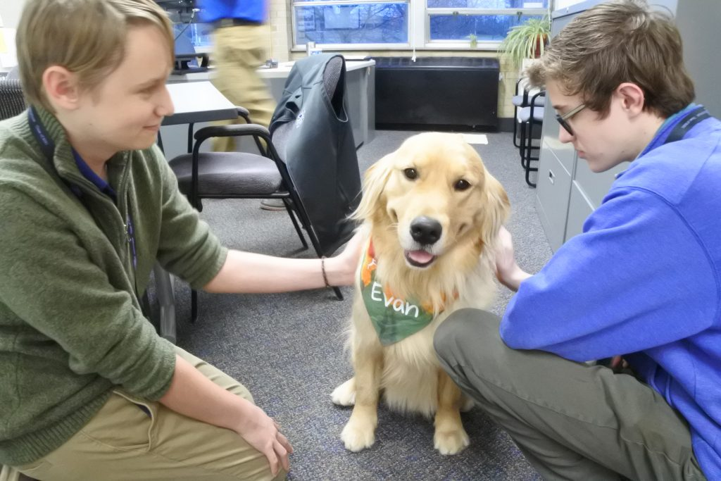 St. Xavier High School is piloting a therapy dog. In partnership with Circle Tail, a nonprofit organization whose mission is to provide service and hearing dogs to people with disabilities, the school will add Evan, a two-year-old Golden Retriever. As part of the pilot, school counselors and the Assistant Principal for Student Services will train as handlers for Evan. Evan is a working dog and conducts himself by a strict set of rules. While his main job is to support students who may be struggling in and around the counselors' offices, he will also work with the entire school community. He will spend most of his time comforting and assisting students in School Counseling and Educational Services.
