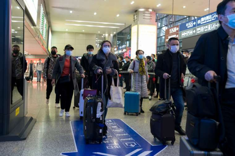 Travellers at an airport in Chengdu, China wear masks to prevent infection from coronavirus, Jan. 23, 2019. Credit: B.Zhou/Shutterstock.