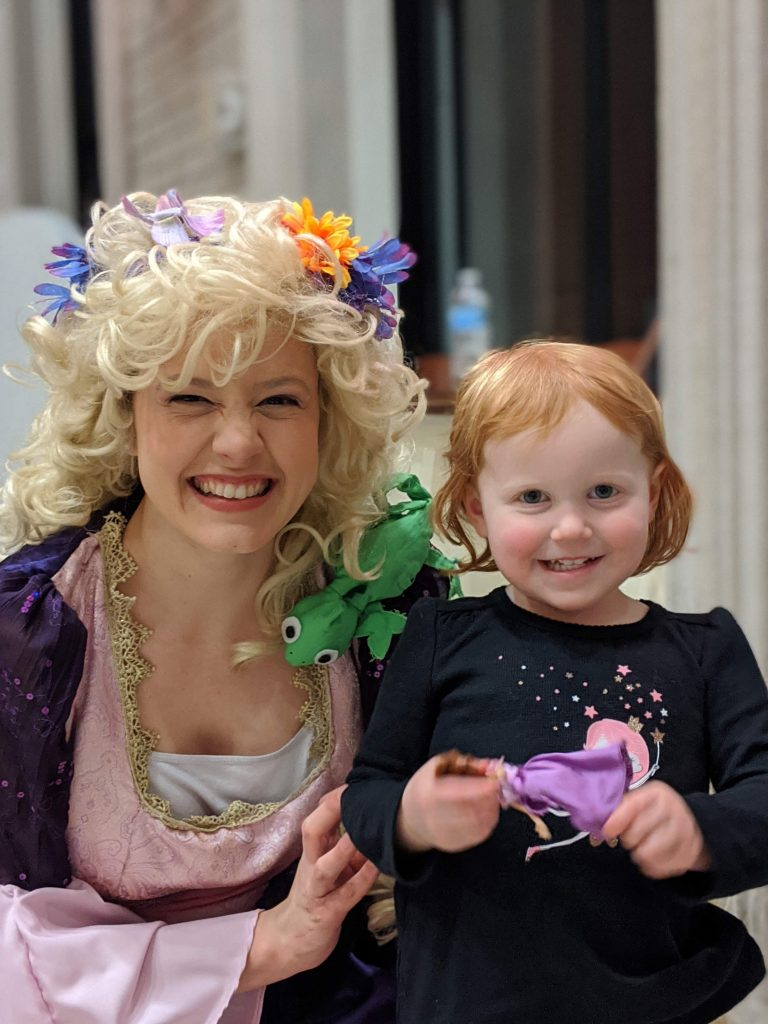 The Angelico Project Family Movie Night presented Tangled-Discovering Christian Symbolism on Jan. 10 at Our Lady of the Holy Spirit Center. The evening included instruction in Christian allegory by Joan Ratajczak and a viewing of Disney's version of the Rapunzel fairy tale, Tangled. Pictured are the Princess Rapunzel (Gracie Francomb) and one of her dear admirers.