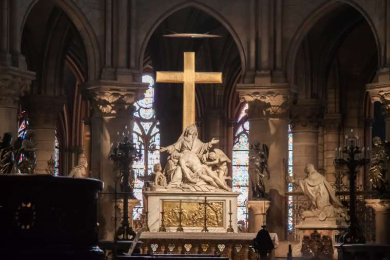 The Descent from the Cross, also known as Pieta, statue inside the Cathedral Notre-Dame de Paris before the fire. Credit: Jeanne Emmel/Shutterstock.