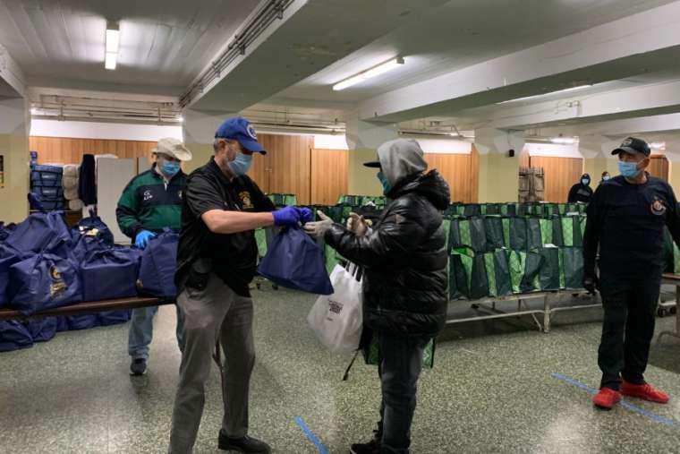 Catholic Charities distribute food at St. Michael – St. Malachy Parish, Brooklyn. April 24, 2020. Credit: Diocese of Brooklyn
