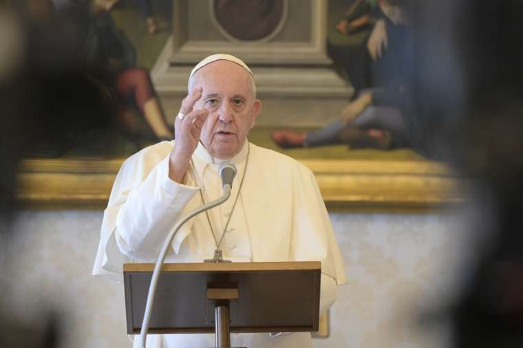 Pope Francis gives a blessing from the apostolic library after the Regina coeli April 26, 2020. Credit: Vatican Media.