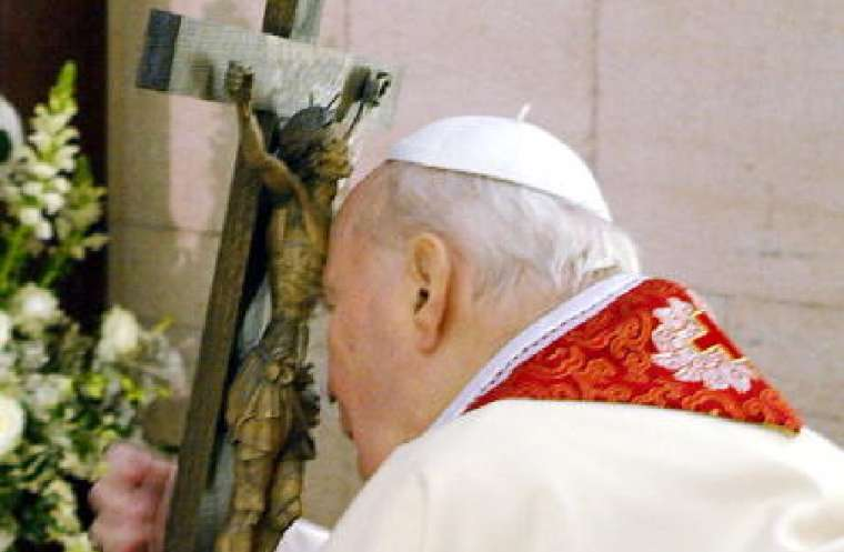 Pope John Paul II attends the Stations Of The Cross ceremony from his private chapel on March 25, 2005 in Vatican City. Credit: Arturo Mari -
