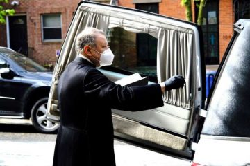 Monsignor Kieran Harrington blesses the coffin of Fr. Jorge Ortiz-Garay before its trip to Mexico. Credit: Diocese of Brooklyn